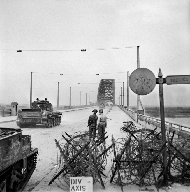 Cromwell tanks of the 2nd Welsh Guards cross the bridge at Nijmegen, September 21, 1944.