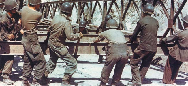 Late in 1942, the U.S. Army's 551st Engineer Heavy Pontoon Battalion assembled a Bailey bridge 590 feet long supported by 25-ton pontoons at Rome Ferry, Tennessee.