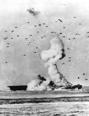 Navy photographer William Barr snapped this dramatic moment as a kamikaze exploded on the flight deck of the USS Enterprise, May 14, 1945.