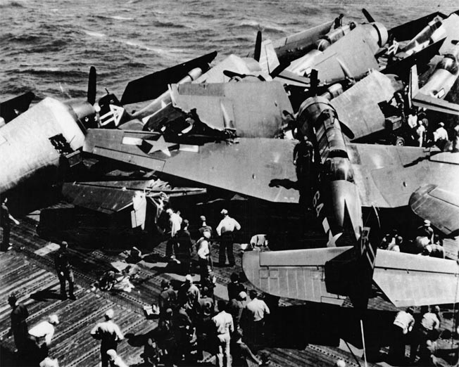 Barr also took this shot after a TBM Avenger missed the arresting wire during landing and crashed into parked planes onboard the Enterprise, April 11, 1945.