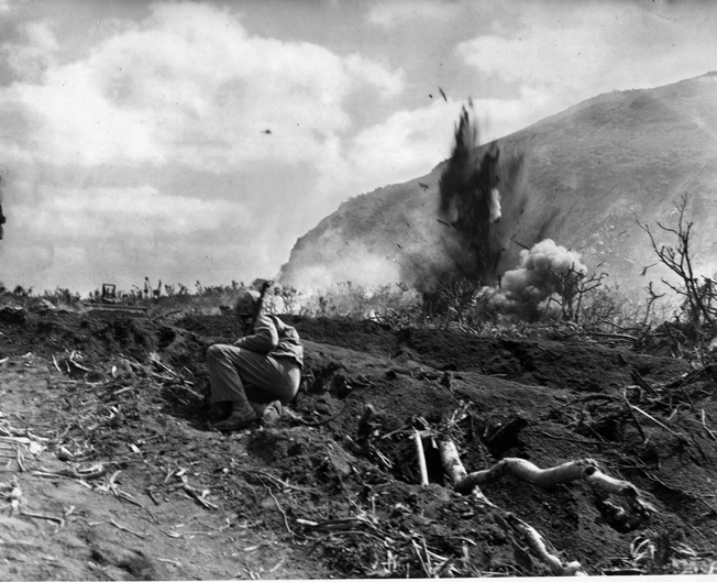 During the landing on Iwo Jima, Basilone led his men off the beach, destroyed a Japanese blockhouse, and helped guide a tank through a minefield before his luck ran out.