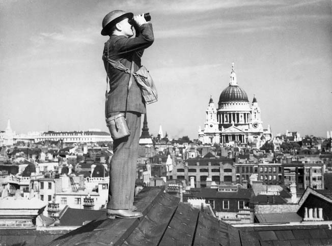 Before the great raid of December 29, a Royal Observer Corps spotter looks for approaching German aircraft. St. Paul's is visible in distance.