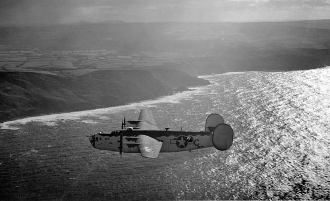 Painted in a camouflage scheme to blend in with sky and sea, the Consolidated PB4Y-1 Liberator Calvert n' Coke was photographed from an accompanying aircraft near the end of a 12-hour flight over the Bay of Biscay hunting for German U-boats. The Liberators had sufficient range to patrol the extensive area and return to their bases in England.