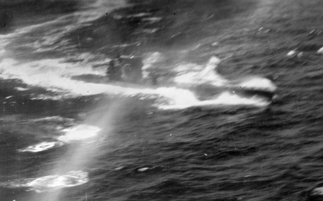 Forced to the surface by depth charges, a German U-boat takes evasive action off the coast of Portugal in August 1943. The Consolidated B-24 Liberator that is mounting the attack is under the command of pilot William Pomeroy.