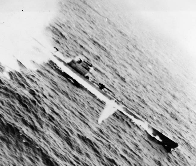 This photo was snapped by a crewman aboard the Consolidated PB4Y-1 Liberator nicknamed Tidewater Tillie as the bomber pressed home its attack against a German U-boat in the Bay of Biscay. The crew dropped depth charges and forced the submarine to the surface before finishing it off.