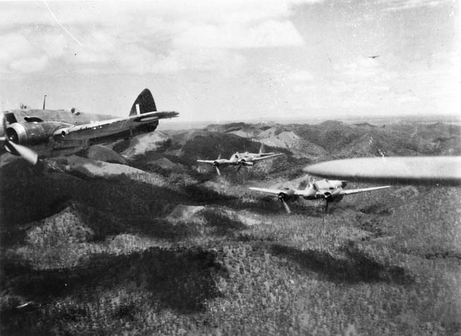 The Bristol Beaufighter was used extensively in the Pacific Theater and on the Asian mainland. In this photo a formation of Royal Australian Air Force Beaufighters flies over the Finschhafen, New Guinea, area.
