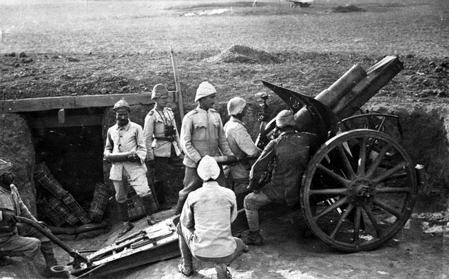 An Ottoman artillery crew fires a German-made 105mm field howitzer.