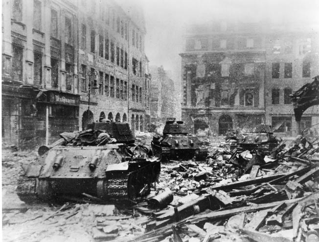 Knocked-out tanks sit amid the rubble of once beautiful Berlin. It is estimated that the battle for the city cost the Soviets more than 300,000 casualties, including 70,000 dead. German military losses are estimated at 150,000-175,000 killed and wounded, with more than 125,000 civilians dead.