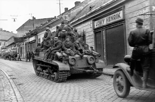 Hungarian troops ride a 41 M Turan II tank during the withdrawal of German and Hungarian troops from Romania to Hungary in August 1944. The Turan is also towing a truck.