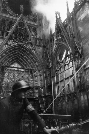 Rouen firefighters work to extinguish flames inside the Notre-Dame Cathedral, which suffered severe damage on May 30-31, 1944.