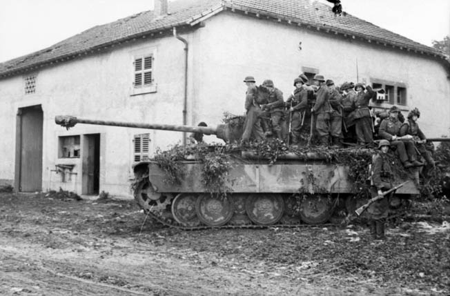 A German Panther carries panzer grenadiers into action at Bures south of Arracourt. Newly established panzer brigades were committed piecemeal in Lorraine against General George Patton's Third Army only to be mauled by the Americans.