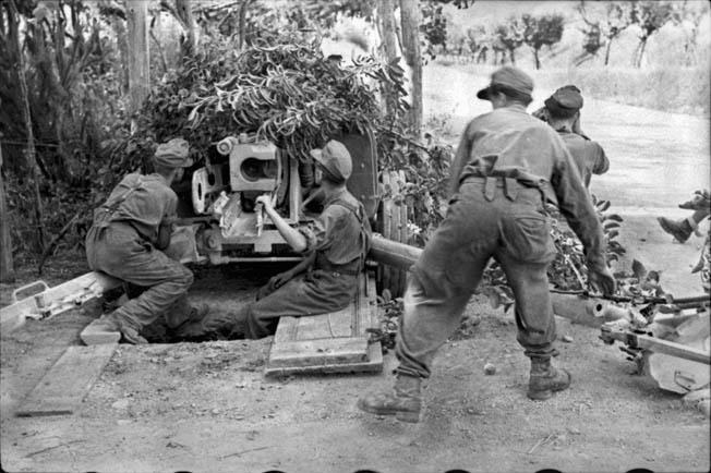 Germans fire an antitank gun at Eighth Army troops near Rimini on the Adriatic coast, September 1944.