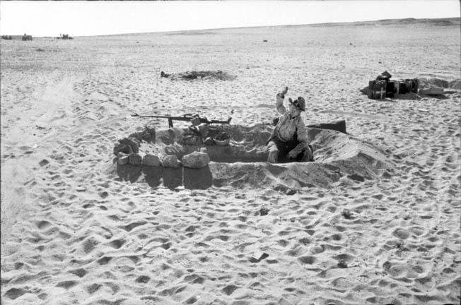 Cover was non-existent during much of the fighting in the North African desert. Here German paratroopers have created a machine-gun position out of sand and rocks. It was during fighting in the desert in May 1943 that Statetzny was captured by the British.