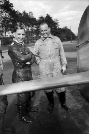 Fw-190 designer Kurt Tank with Luftwaffe pilots. Tank incorporated into his design two 20mm cannons capable of firing a high-explosive round.