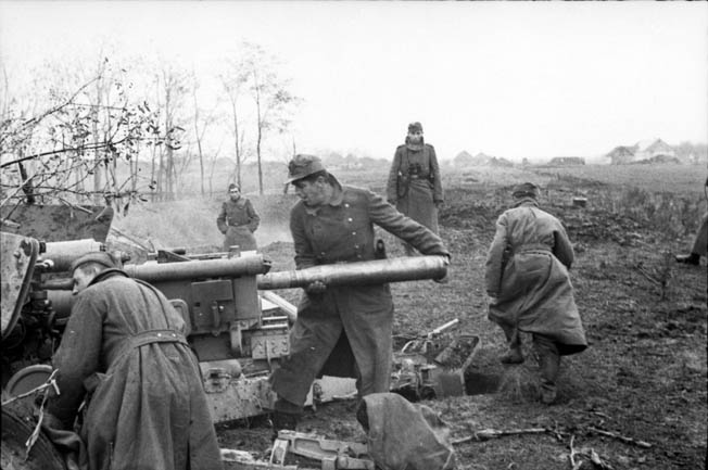 Defending their position in southern Ukraine in December 1943, these German soldiers are loading a heavy artillery piece. German efforts to take Kiev at the end of 1943 were thwarted by Red Army counterattacks.