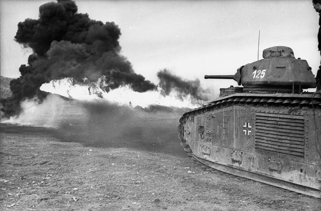 During their successful campaign against France in the spring of 1940, the Germans captured large numbers of French tanks and pressed them into service with the Wehrmacht. Here, a French-made Char B1, converted to a flammpanzer or flamethrower tank, is seen in action in southern Ukraine.