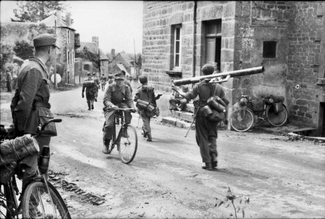 German soldiers head for the front lines in Normandy in this photo taken sometime in June 1944 after the Allied D-Day landings. The Germans were surprised by the landings but proved resilient and put up stiff resistance at crucial points in Normandy such as the La Fière causeway.