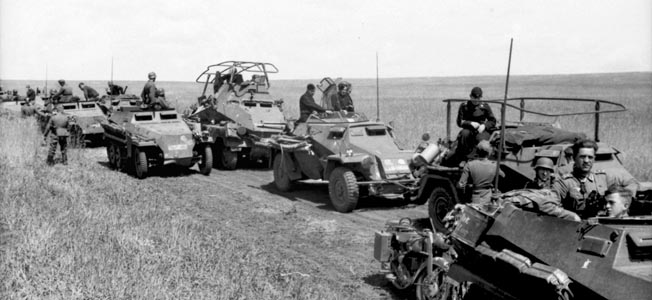 Reconnaissance troops of Panzergrenadier Division Grossdeutschland cross the Ukrainian steppe northwest of Kharkov. Pictured with half-tracks are an SdKfz.222 light armored vehicle and the SdKfz.263 heavy armored command vehicle.