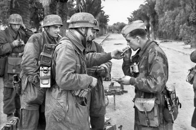 "Members of Fallschirm Brigade ""Ramcke"" take a cigarette break during an operation in Tunisia, November 1942. Statetzny avoided capture while with the Ramcke Brigade."