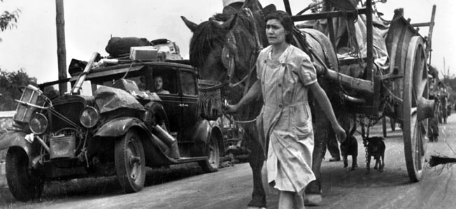 The 1940 exodus from Paris as the German Army approached choked the roads from the city with refugee traffic.