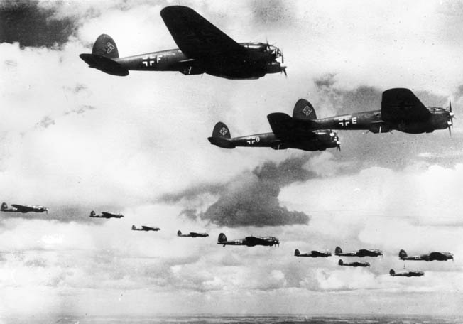 A formation of Heinkel He-111 bombers photographed en route to England in 1940. The first air raid on London took place on September 7/8, 1940.