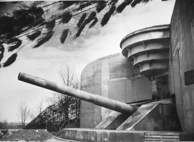 An enormous 406mm gun points menacingly toward the English Channel from one of the casemates at Batterie Lindemann. The thick concrete walls and roof were impervious to shellfire; the casemates could only be taken out by infantry assault.