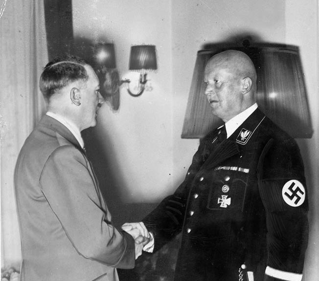 Adolf Hitler congratulates Hans Lammers, Chief of the Reich Chancellery, on the occasion of Lammers' 60th birthday, May 27, 1939. Lammers was convicted of war crimes by a 1949 tribunal and served approximately 10 percent of his 20-year sentence.