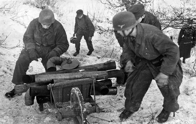 German paratroopers prepare to construct a temporary bunker during the final days of the Ardennes Offensive, January 1945.
