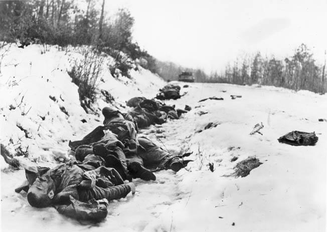 Soviet troops slain in combat lay in a snow-covered ditch in Hungary. When the snow thawed in early March 1945, German panzers bogged down in mud that slowed their advance to a crawl.