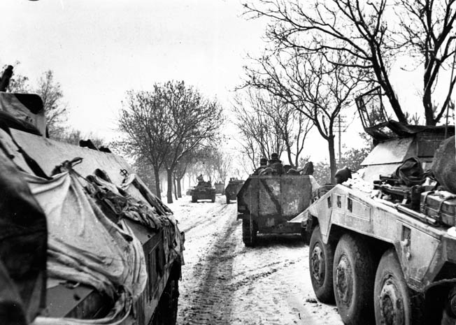 In this photo taken in February 1945, a collection of German armored vehicles moves forward along a snowy road to counterattack the advancing Soviet Red Army. At this point, the Red Army was nearing the Oder River, and the Germans were hard pressed to maintain an effective defense.