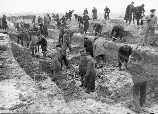 Berliners dig an antitank trench and other defensive works outside the city in hopes of stopping an all-out Soviet assault.
