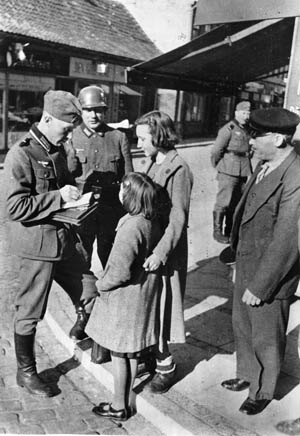 Life under Nazi rule was difficult for most Danes. Here, two Danish girls are stopped and questioned by German occupation troops.
