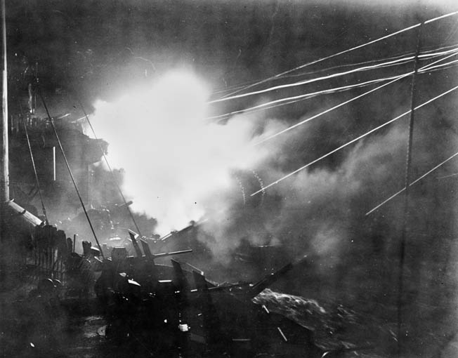 The cruiser USS Boise was damaged during the battle. Repaired and returned to service, the cruiser is shown firing at the enemy during another night engagement in 1944.