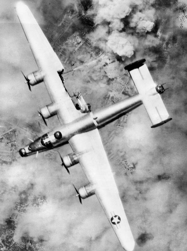 A B-24, with a portion of its right wing damaged by antiaircraft fire during a raid over France in August 1944. The U.S. Eighth Air Force lost approximately 6,000 B-24s and B-17s in operational sorties throughout the war in various theaters. Over 30,000 U.S. airmen were killed or went missing and another 30,000 were captured, making life in the air force extremely hazardous.