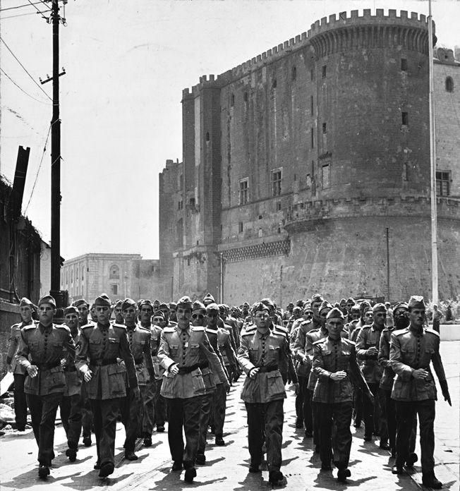 The BEF, in their distinctive dress uniforms, parade past Naples' Castel Nuovo shortly after their arrival, July 1944. Led by Major General João Baptista Mascarenhas de Moraes, Brazil would provide over 25,000 troops to the Allied cause.