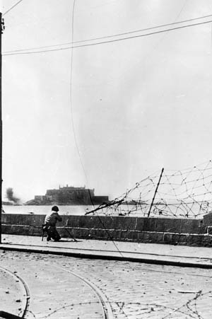An American soldier views the stout, formidable walls of the Citadel at St. Malo. Surrounded on three sides by water, the medieval fortress held out for 11 days against fierce shelling and bombing.