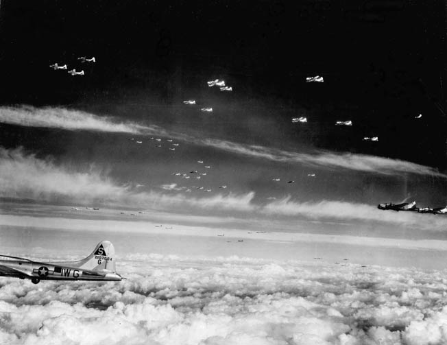 A flight of 401st Bomb Group B-17s on their way from their base at RAF Deenethorp, England, to bomb targets in Germany. The 401st hit Gustloff-Werk II from over 23,000 feet.