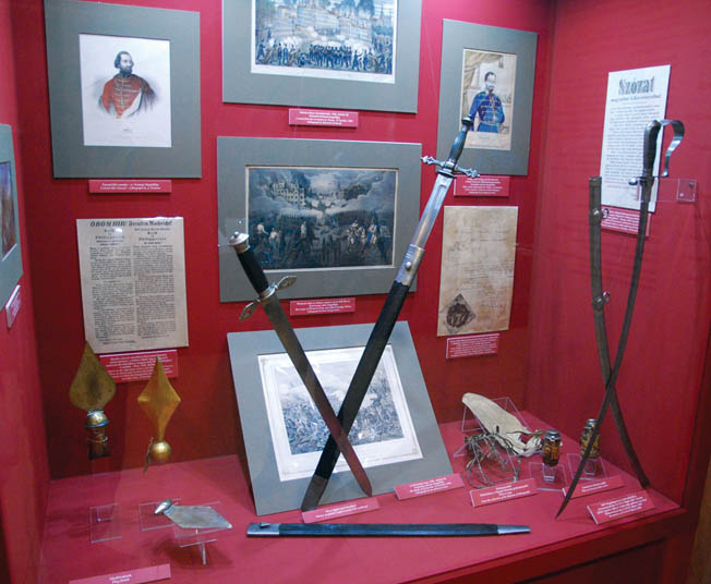 A display features swords and other weapons that were used by Hungarian nationalists during the revolution.
