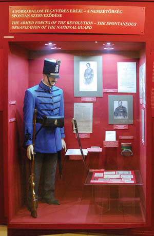 An exhibit depicts the dress of a Hungarian National Guard soldier during the 1848 revolution. With Russian aid through the 1815 Holy Alliance to restrain European republicanism, the Hungarian uprising was crushed and the country remained part of the Austrian Empire.