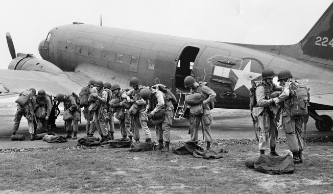 """A """"stick"""" of 101st Airborne paratroopers prepares for a practice jump in England. Buford made his required five jumps before flying to France and joining Colonel Julian Ewell's 501st Parachute Infantry Regiment."""