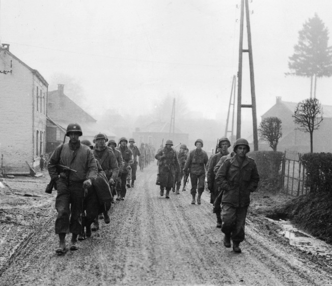 "After delaying the Fifth Panzer Army's attack along the Our River, frost-bitten and exhausted men of the 28th (""Keystone"") Infantry Division retire to Bastogne."
