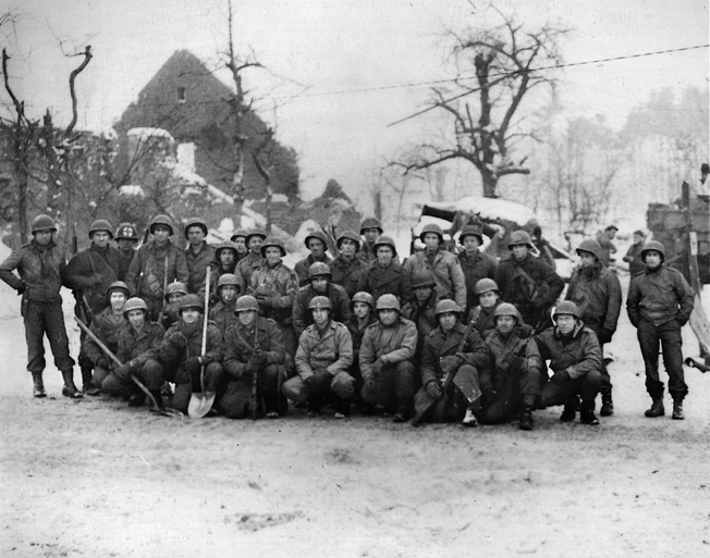 Men of Company C, 291st Combat Engineer Battalion, pose for a photographer near Malmédy after the crisis had ended.