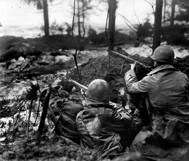 Soldiers of the 99th Infantry Division are on the alert for the enemy. The snow and sub-freezing conditions added more misery to the combat experience.