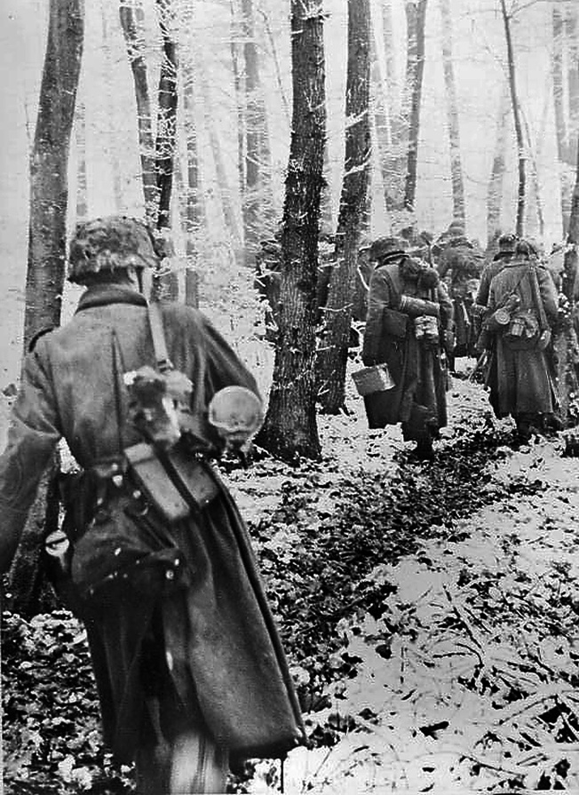 Men of the 26th Volksgrenadier Division attempt to enter Bastogne from the north through Noville. That they did not succeed was due to a savage defense by Team Desobry—20th Armored Infantry Battalion, 10th Armored Division, plus engineer and airborne troops.