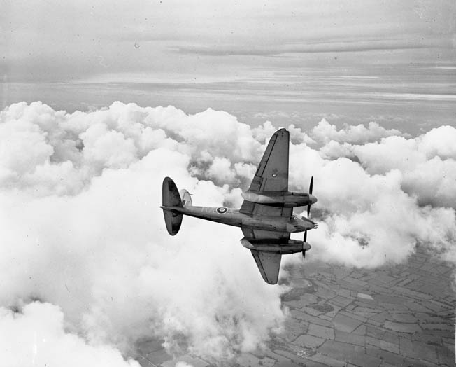 "Made almost entirely out of wood, the ""Mossie"" was light, fast, and agile. Pilots loved it and opponents feared it. Here a de Havilland Mosquito Mark II of No. 456 Squadron, RAAF, based at Middle Wallop, Hampshire, banks away from the camera."