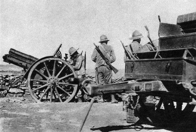 In 1939, at the request of President Roosevelt, Donovan traveled to Africa to report on the Italian-Ethiopian war that was then raging. Here an Italian artillery crew prepares to fire its 65MM gun at native troops.