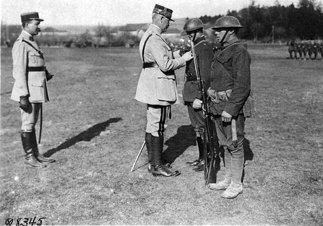 Donovan was a true war hero, awarded the Medal of Honor. Here, as commander of the 1st Battalion, 69th New York Volunteers, in World War I, Major Donovan receives the Legion of Honor from a French general.