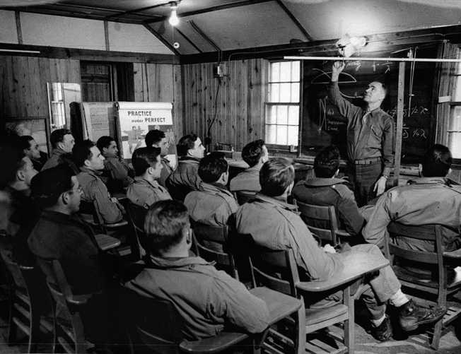 OSS candidates, slated to be dropped behind enemy lines, learn how to set up a clandestine radio antenna.