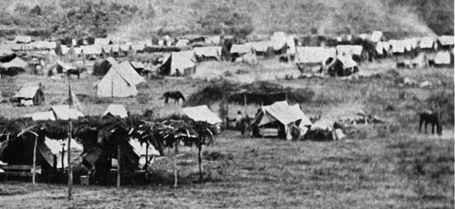 The Union camp in Baton Rouge at the close of Grierson's campaign. Note the brush arbors erected around the officers' tents to provide extra cover from the elements.