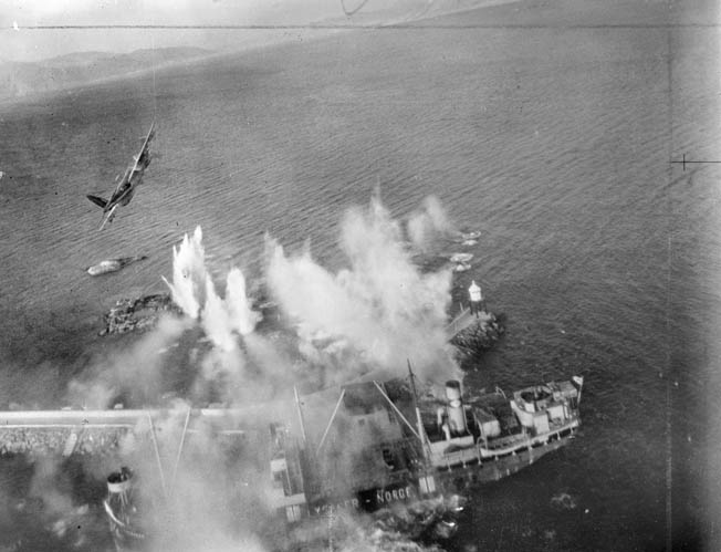 Capable of carrying a 4,000-pound bomb payload, Mosquitos were ideally suited for precise, low-level attacks. Here a Mosquito FB Mark VI attacks a German vessel with rockets in the harbor of Tetgenaes, Norway, March 1945.